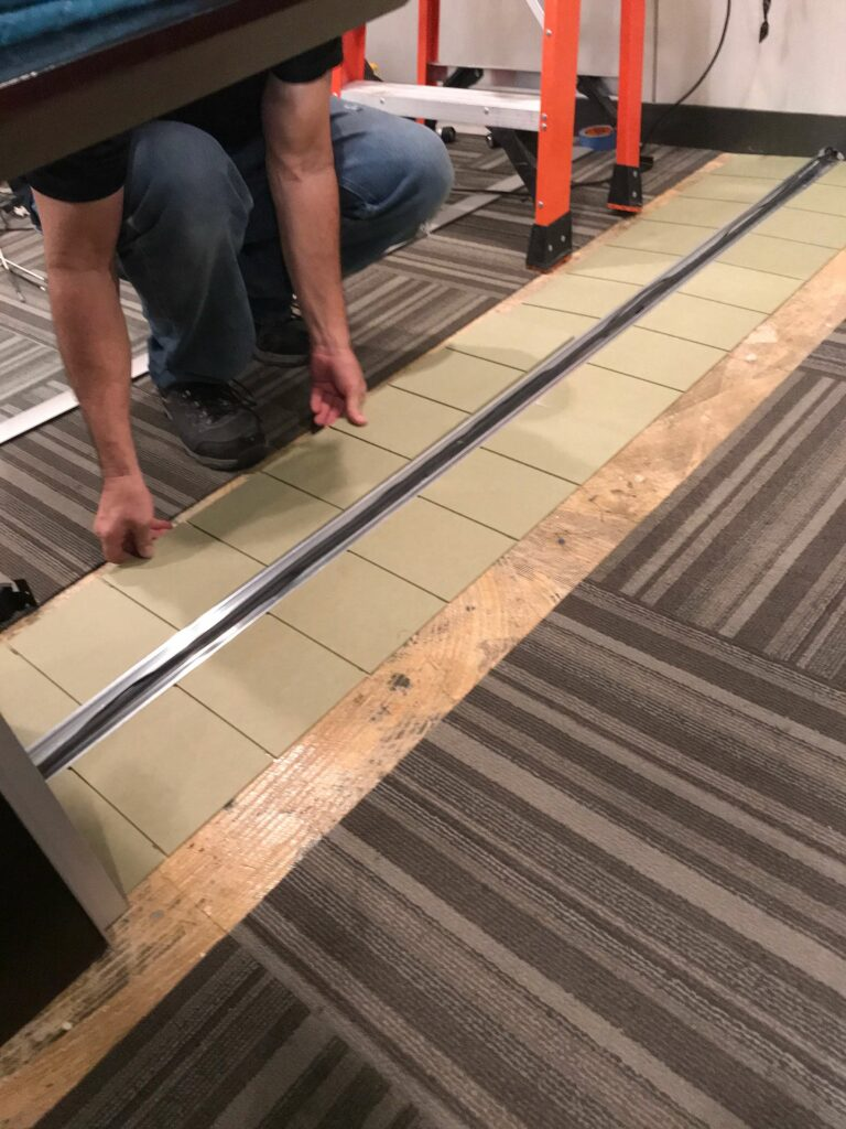Providing Floor Track For Table Connectivity